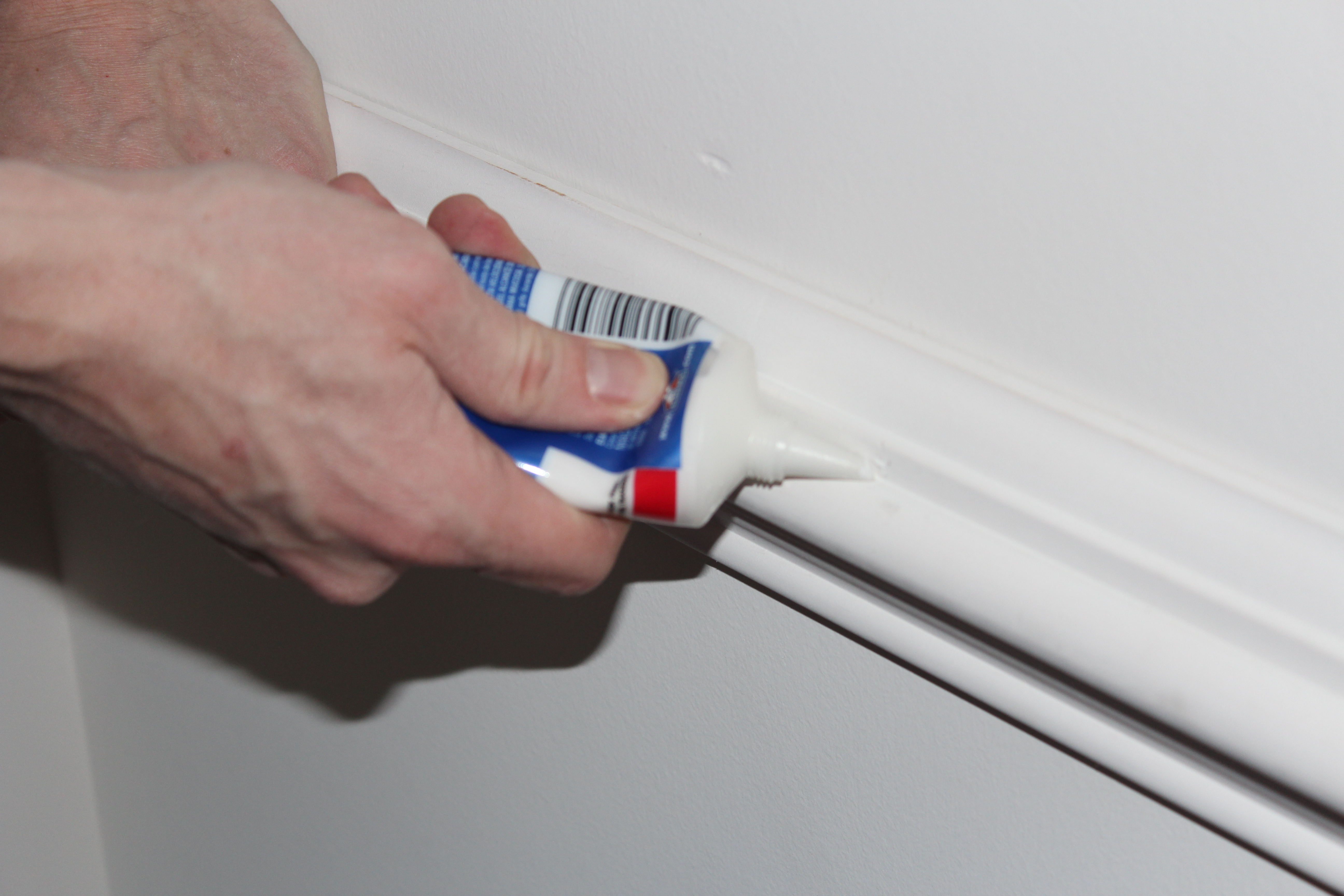 smooth paint finish paint the handy mano caulk crack wood trim wall