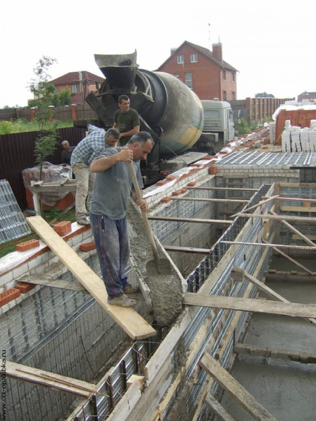 Lay the concrete into your natural swimming pool walls