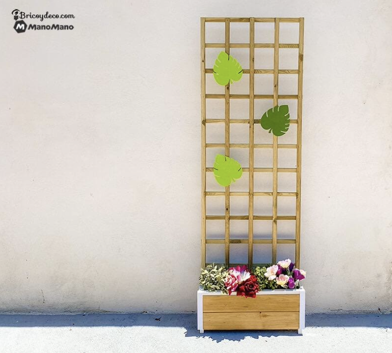 Add some greenery to the wooden trellis planter