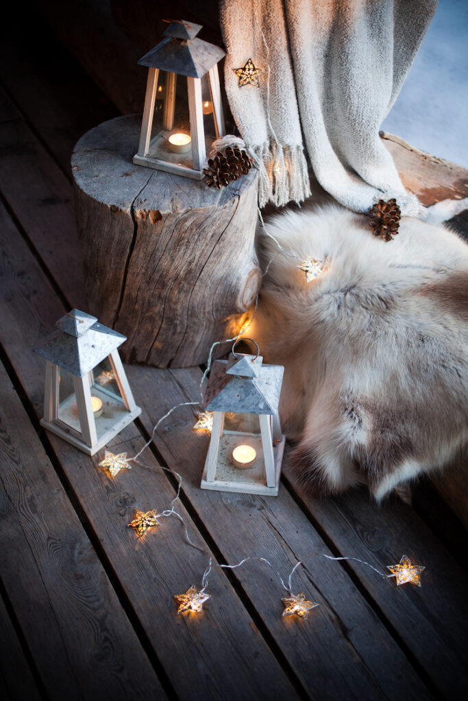 Outdoor Christmas decorations including wood and twinkling lights